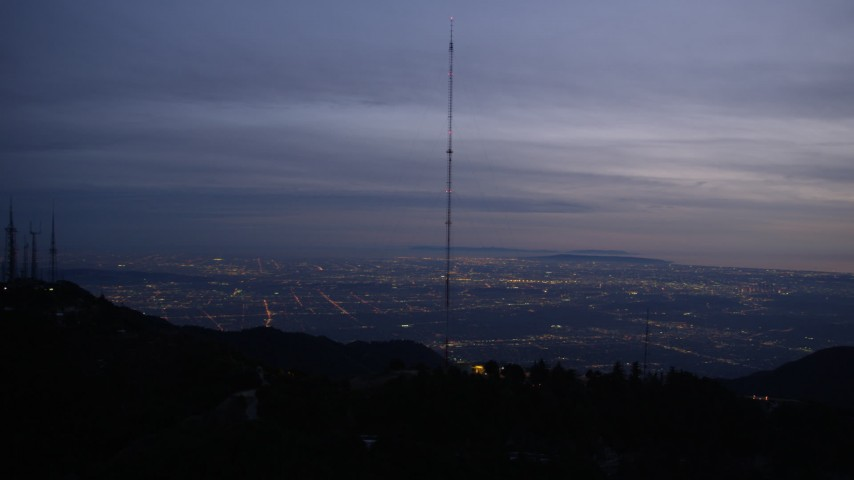 5K stock footage aerial video orbiting radio tower on a mountain in the San Gabriel Mountains at twilight, California Aerial Stock Footage | AX0008_057