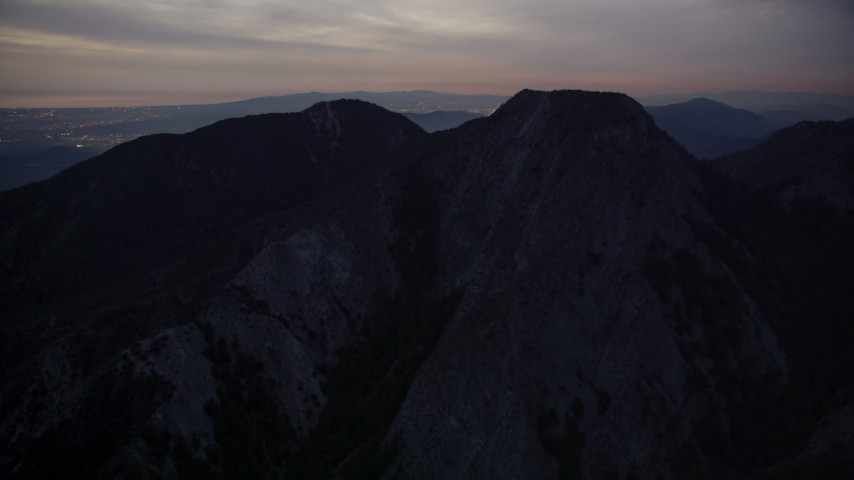 5K aerial video of approaching peaks in the San Gabriel Mountains in California at twilight Aerial Stock Footage | AX0008_058