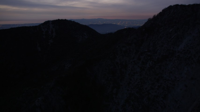 5K aerial video of approaching peaks in the San Gabriel Mountains at twilight, California Aerial Stock Footage | AX0008_059
