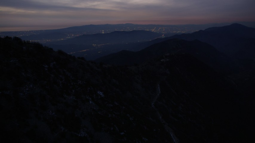5K aerial video fly over peaks in the San Gabriel Mountains at twilight, California Aerial Stock Footage | AX0008_060