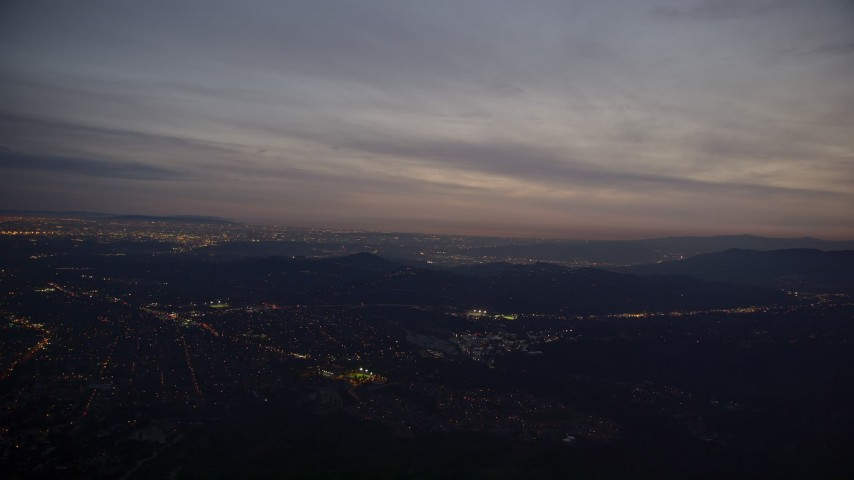 5K stock footage aerial video approach Jet Propulsion Lab from San Gabriel Mountains at Night, California Aerial Stock Footage | AX0008_063