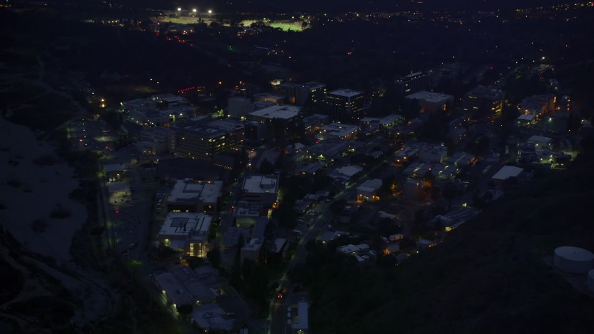 5K stock footage aerial video of approaching Jet Propulsion Laboratory at night in Pasadena, California Aerial Stock Footage | AX0008_066