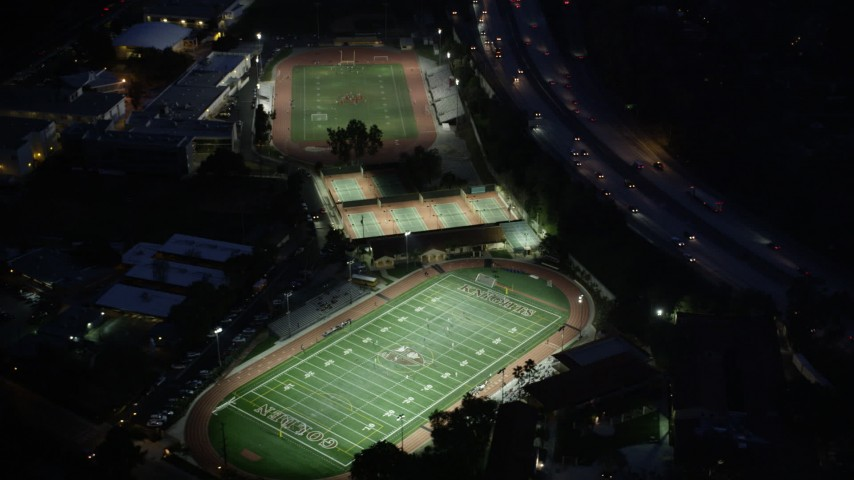 5K stock footage aerial video orbit football and track fields at night in La Cañada Flintridge, California Aerial Stock Footage | AX0008_068
