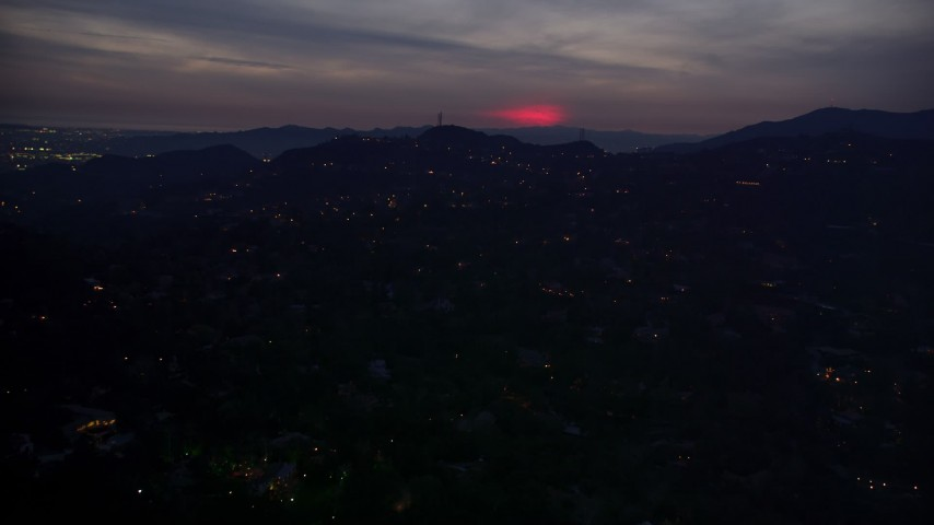 5K stock footage aerial video of a red glow in clouds above hillside homes in La Cañada Flintridge at night, California Aerial Stock Footage | AX0008_070
