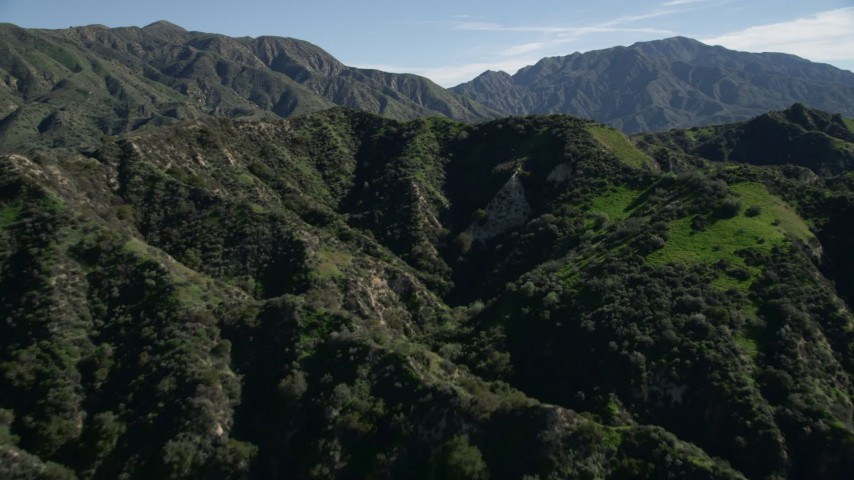 5K stock footage aerial video of flying over green ridges in the San Gabriel Mountains, California Aerial Stock Footage | AX0009_003