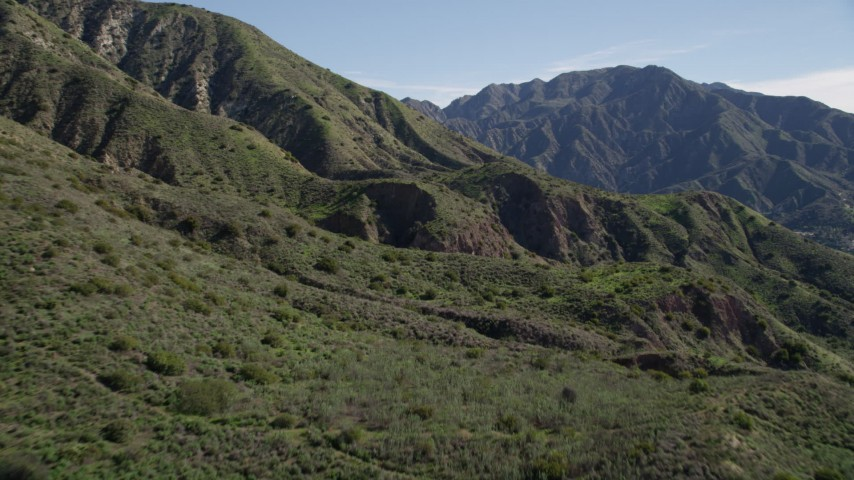 5K stock footage aerial video approach steep slopes of green peaks in the San Gabriel Mountains, California Aerial Stock Footage | AX0009_006