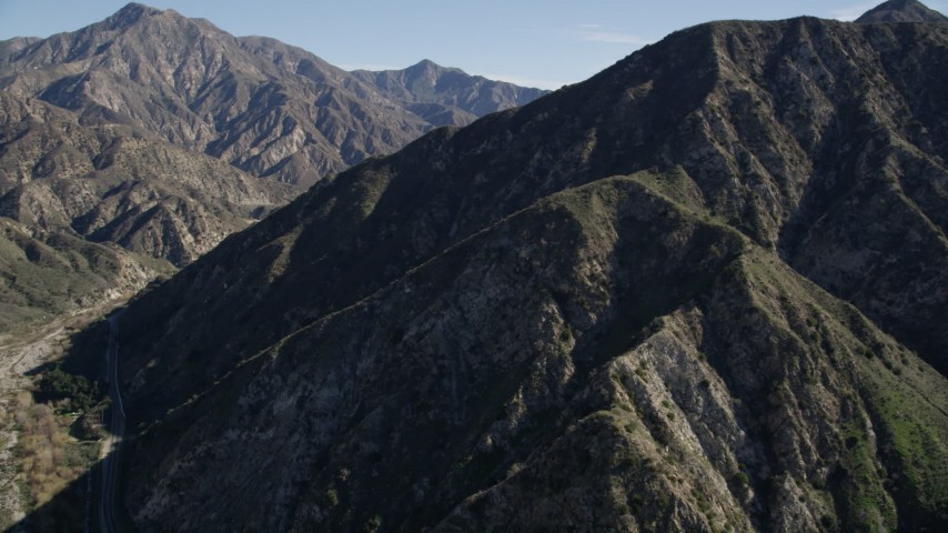 5K stock footage aerial video approach and fly over green ridges in the San Gabriel Mountains, California Aerial Stock Footage AX0009_009 | Axiom Images