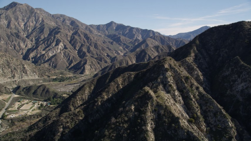 5K stock footage aerial video fly over and approach ridges in the San Gabriel Mountains of California Aerial Stock Footage | AX0009_010