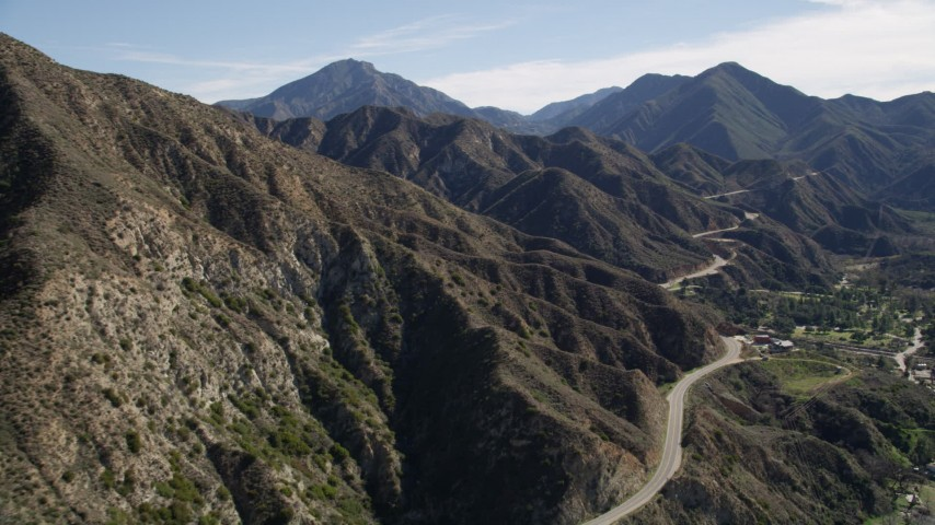 5K aerial video of a mountain road and ridge in the San Gabriel Mountains, California Aerial Stock Footage AX0009_014