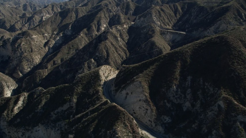 5K aerial  video pan across a lonely road in the San Gabriel Mountains, California Aerial Stock Footage | AX0009_018