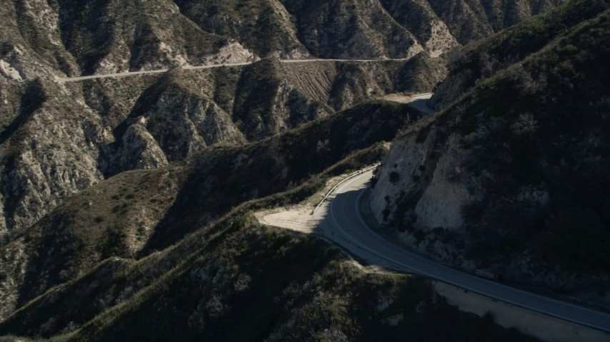 5K aerial video of tracking a motorcyclist on a road in the San Gabriel Mountains, California Aerial Stock Footage | AX0009_021