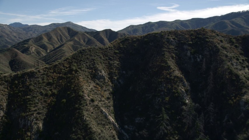 5K stock footage aerial video fly over sharp ridge and approach green mountains of the San Gabriel Mountains, California Aerial Stock Footage | AX0009_029