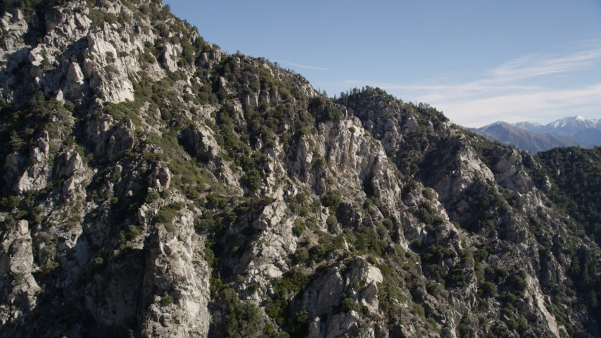 5K stock footage aerial video approach jagged and rocky slopes in the San Gabriel Mountains, California Aerial Stock Footage | AX0009_033