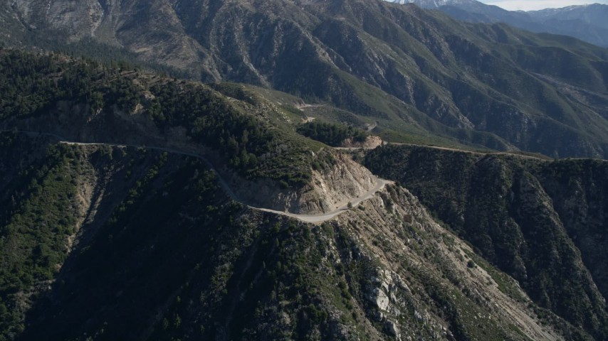5K stock footage aerial video descend toward a road in the San Gabriel Mountains, California Aerial Stock Footage | AX0009_037
