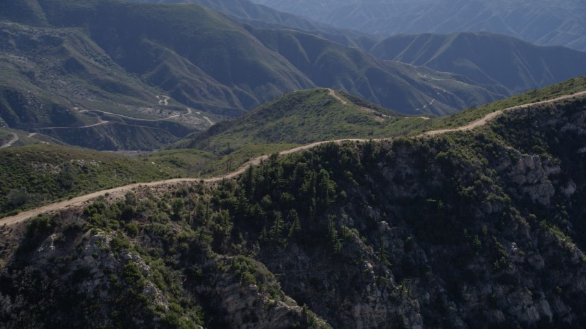 5K stock footage aerial video orbit dirt road on a ridge in the San Gabriel Mountains, California Aerial Stock Footage | AX0009_038