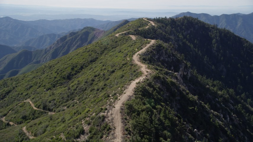 5K stock footage aerial video orbit dirt road on a ridge in the San Gabriel Mountains, California Aerial Stock Footage | AX0009_039