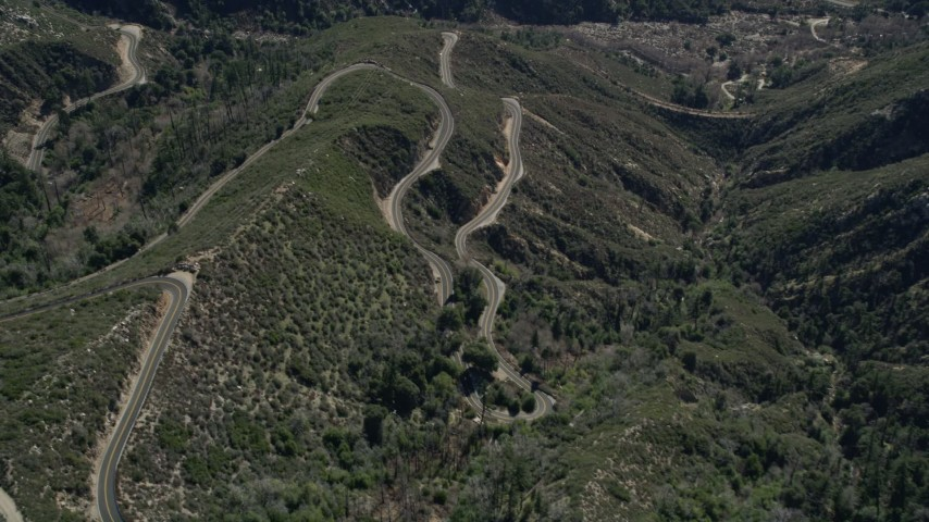 5K stock footage aerial video of bird's eye view of winding mountain road in the San Gabriel Mountains, California Aerial Stock Footage | AX0009_041