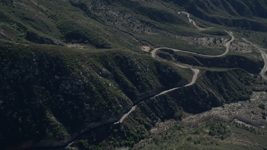 5K stock footage aerial video orbit road at the base of slopes in the San Gabriel Mountains, California Aerial Stock Footage | AX0009_042