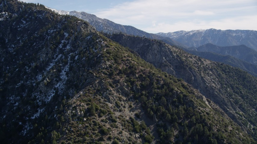 5K stock footage aerial video approach slope with light snow in the San Gabriel Mountains, California Aerial Stock Footage | AX0009_049