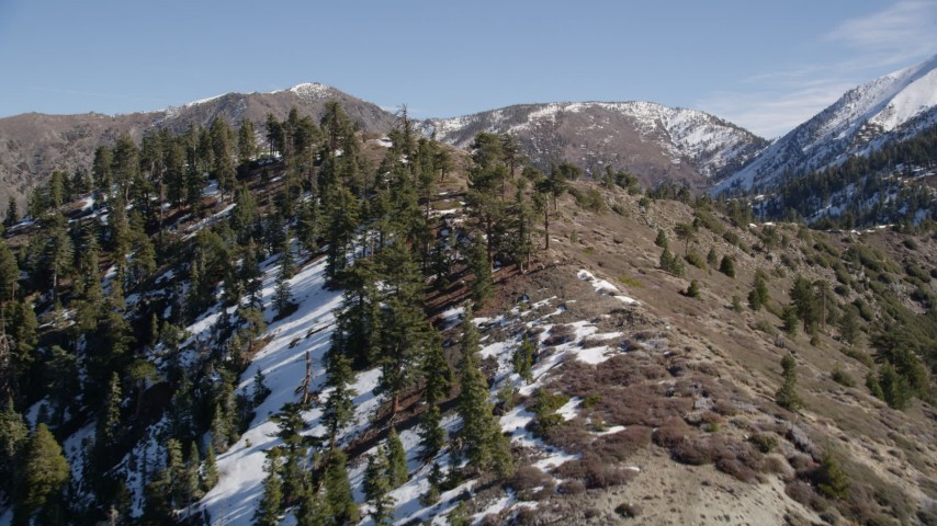 5K stock footage aerial video of a snowy ridge in winter and tilt up in the San Gabriel Mountains, California Aerial Stock Footage   AX0009_055