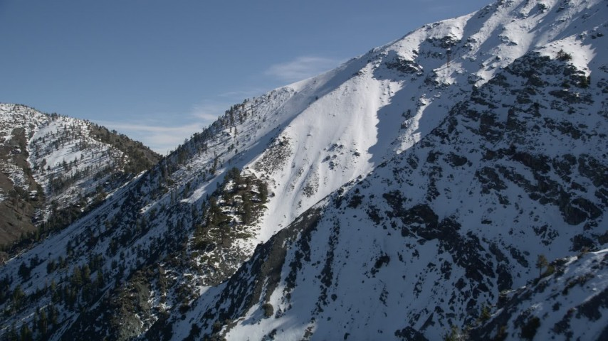 5K stock footage aerial video approach steep snowy mountain peak in the San Gabriel Mountains, California Aerial Stock Footage | AX0009_059