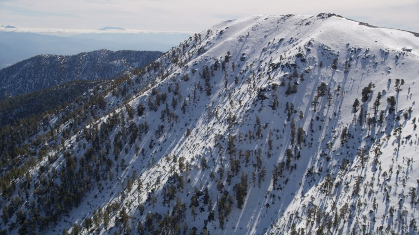 5K stock footage aerial video approach summit of snow-capped peak in the San Gabriel Mountains, California Aerial Stock Footage | AX0009_062