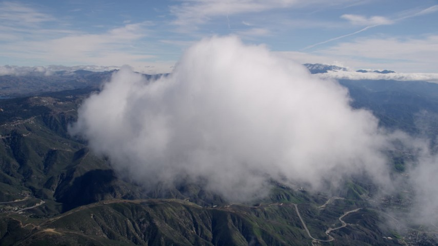 5K stock footage aerial video approach a small cloud over the San Bernardino Mountains, California Aerial Stock Footage | AX0009_072