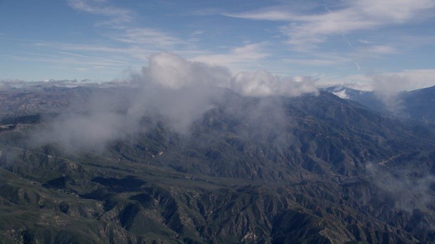 5K aerial video fly through wispy clouds over the San Bernardino Mountains, California Aerial Stock Footage | AX0009_077
