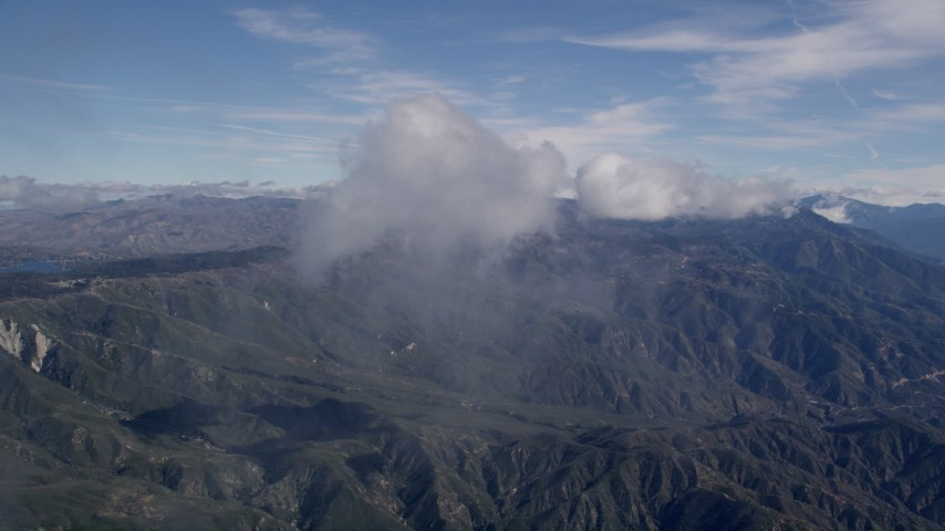 5K aerial video approach clouds over the San Bernardino Mountains in California Aerial Stock Footage | AX0009_078