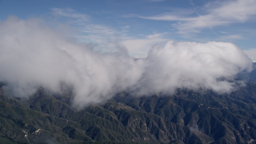 5K stock footage aerial video of a cloud moving over the San Bernardino Mountains, California Aerial Stock Footage   AX0009_082