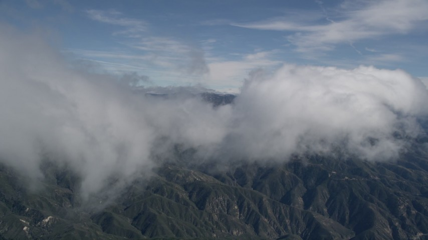 5K stock footage aerial video of a cloud moving over the San Bernardino Mountains, California Aerial Stock Footage   AX0009_082E