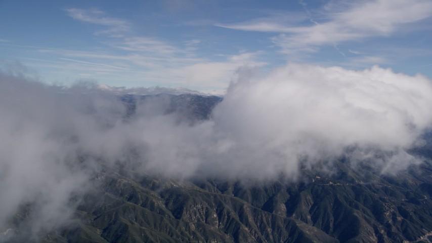 5K stock footage aerial video pan across a cloud over the San Bernardino Mountains, California Aerial Stock Footage   AX0009_083