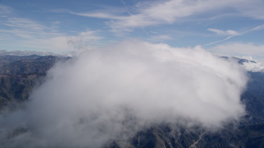 5K stock footage aerial video fly over top of a cloud over the San Bernardino Mountains, California Aerial Stock Footage | AX0009_084