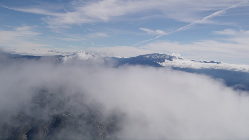 5K aerial video fly over a cloud to reveal the San Bernardino Mountains in California Aerial Stock Footage | AX0009_085