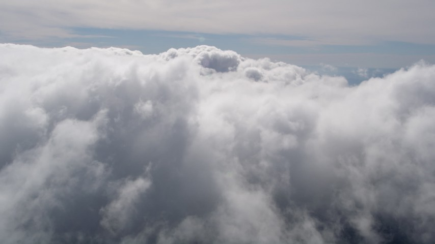 5K stock footage aerial video fly over thick cloud cover over San Bernardino County, California Aerial Stock Footage | AX0009_091