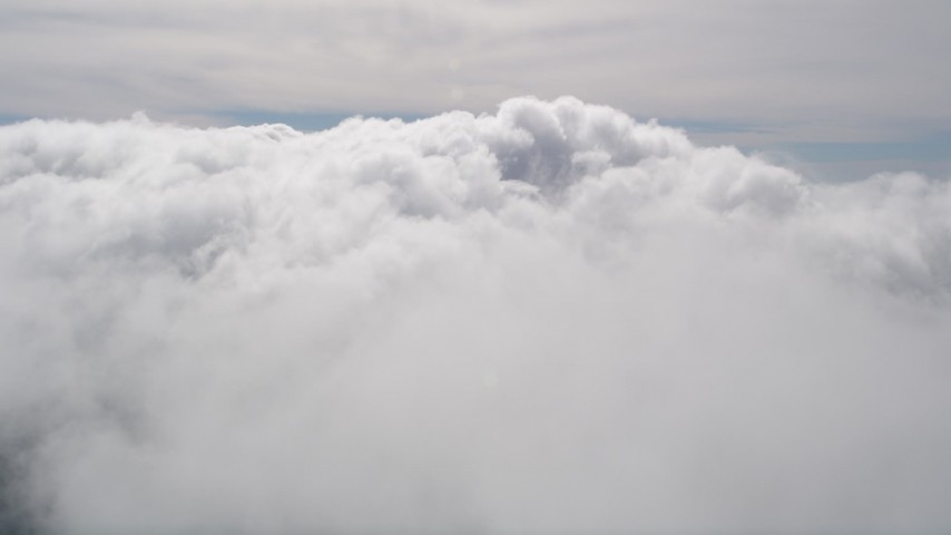 5K stock footage aerial video fly above thick cloud cover in San Bernardino County, California Aerial Stock Footage | AX0009_095