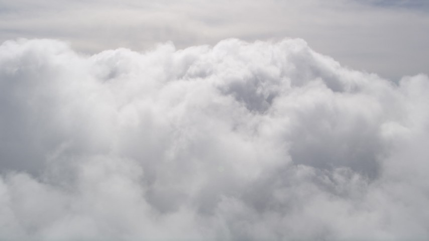 5K stock footage aerial video of a slow approach to thick cloud cover over San Bernardino County, California Aerial Stock Footage | AX0009_097
