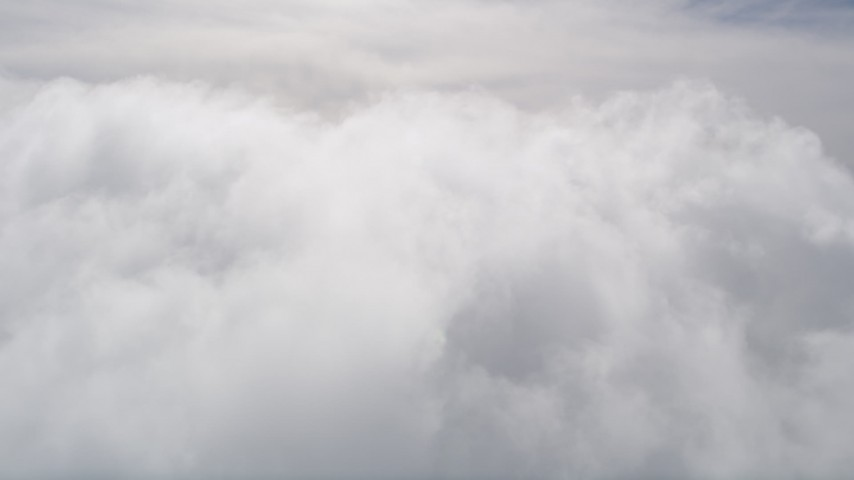 5K stock footage aerial video of flying over thick clouds in San Bernardino County, California Aerial Stock Footage | AX0009_098