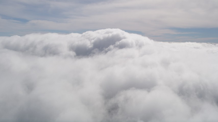 5K stock footage aerial video of fluffy clouds over San Bernardino County, California Aerial Stock Footage | AX0009_099