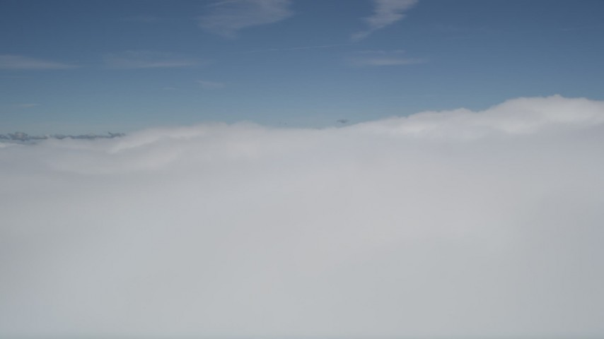 5K stock footage aerial video fly over thick blanket of clouds over San Bernardino County, California Aerial Stock Footage | AX0009_102E