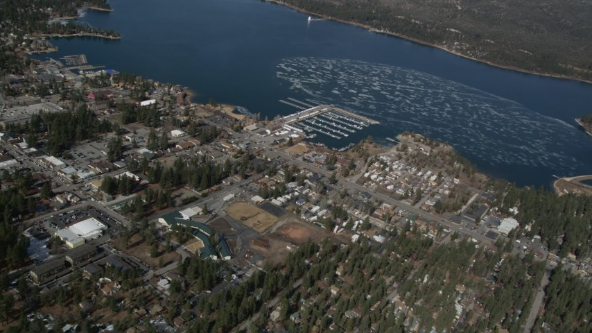 5K aerial video orbit a small lakeside town on Big Bear Lake in winter, California Aerial Stock Footage | AX0009_138