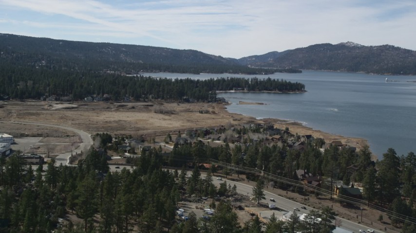 5K stock footage aerial video tilt up from small town homes to reveal Big Bear Lake, California Aerial Stock Footage | AX0010_012