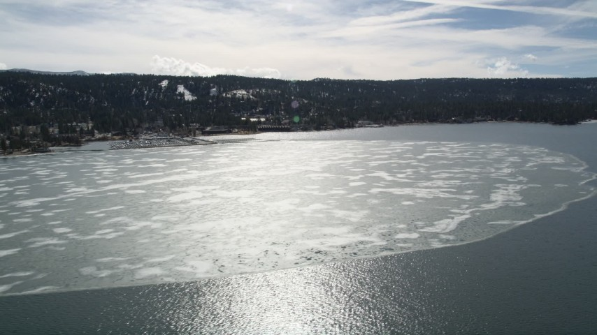 5K aerial video of a large patch of winter ice on Big Bear Lake, California Aerial Stock Footage | AX0010_016