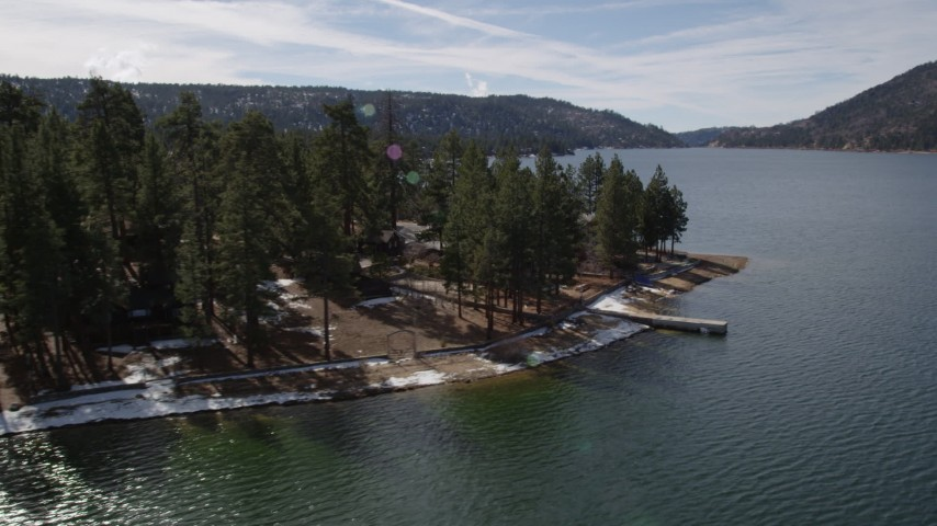 5K stock footage aerial video tilt and reveal waterfront homes with light snow at Big Bear Lake, California Aerial Stock Footage | AX0010_021