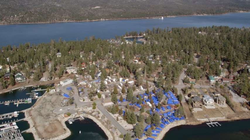 5K stock footage aerial video tilt and approach homes and town on the shore of Big Bear Lake, California Aerial Stock Footage | AX0010_033