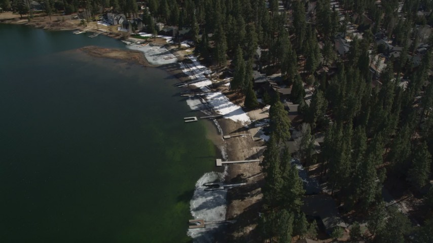 5K stock footage aerial video of bird's eye view of lakeside homes with winter snow at Big Bear Lake, California Aerial Stock Footage | AX0010_037