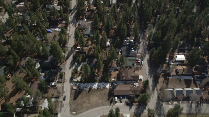 5K stock footage aerial video of bird's eye of small town homes at Big Bear Lake in winter, California Aerial Stock Footage | AX0010_038