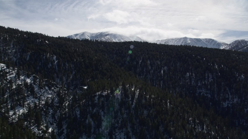 5K stock footage aerial video of forest and mountains with winter snow in the San Bernardino Mountains, California Aerial Stock Footage | AX0010_062