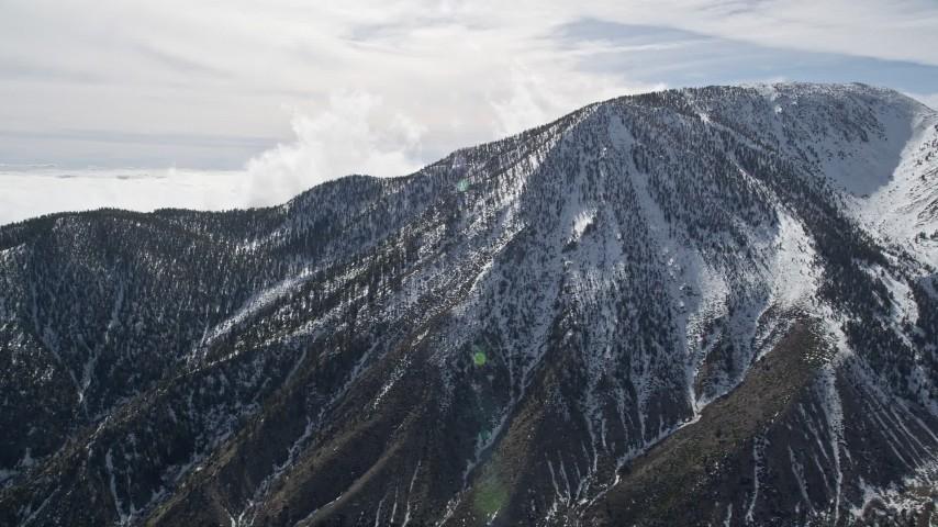 5K stock footage aerial video orbit snowy peak in the San Jacinto Mountains in winter, California Aerial Stock Footage | AX0010_068