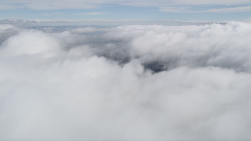 5K stock footage aerial video of orbiting above thick cloud cover in Southern California Aerial Stock Footage | AX0010_076